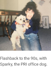 "Elena and Sparky, caption reads ""Flashback to the 90s, with Sparky, the PRI office dog."""